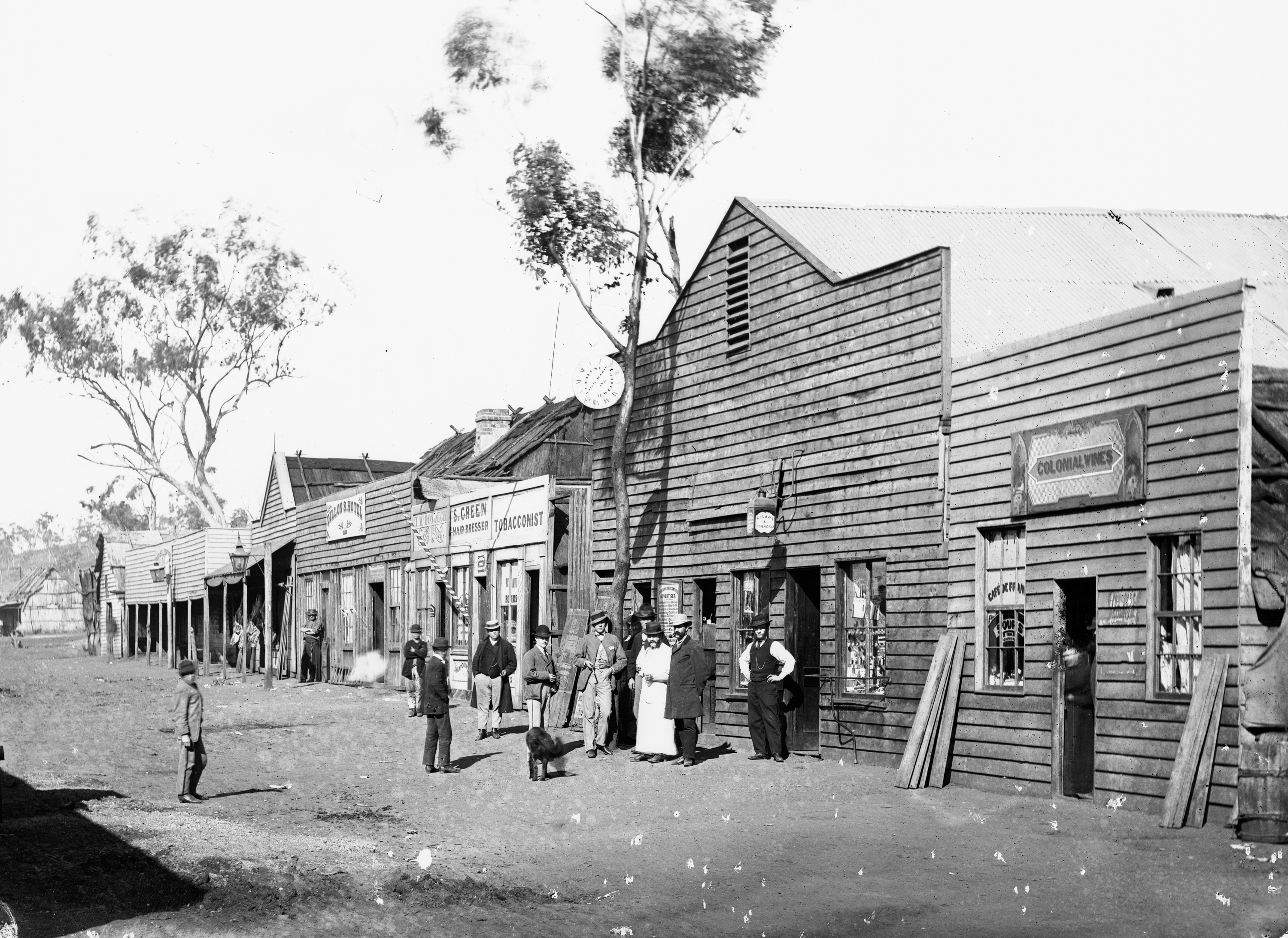 A black and white photograph of an 1800s main street.