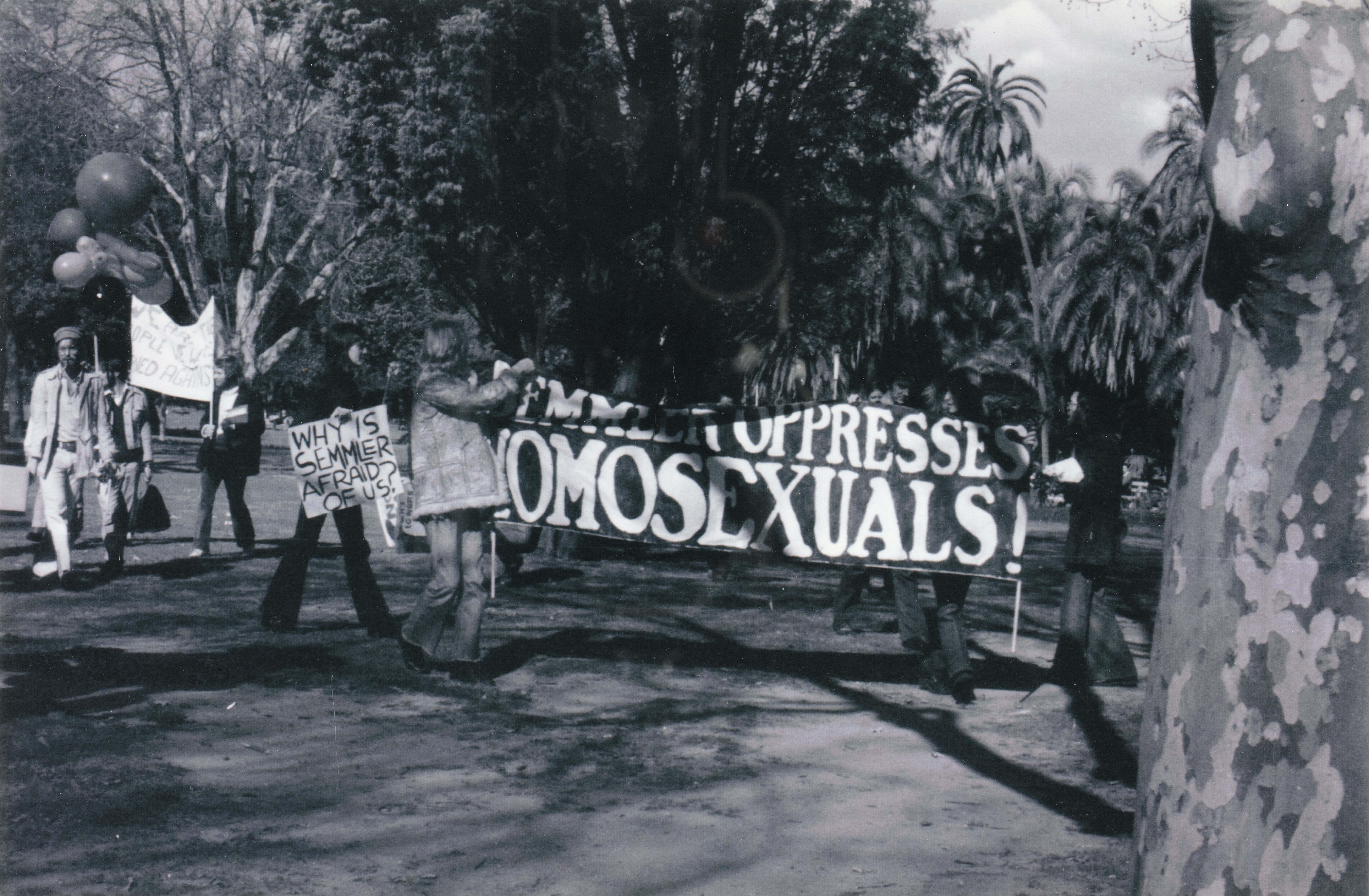 Banner: 'Semmler Oppresses Homosexuals', CAMP/Sydney Gay Lib demonstrators in Hyde Park on their way to ABC Headquarters, Castlereagh Street, Sydney.