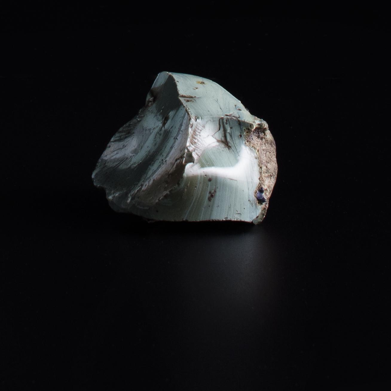 Piece of light blue opaque glass