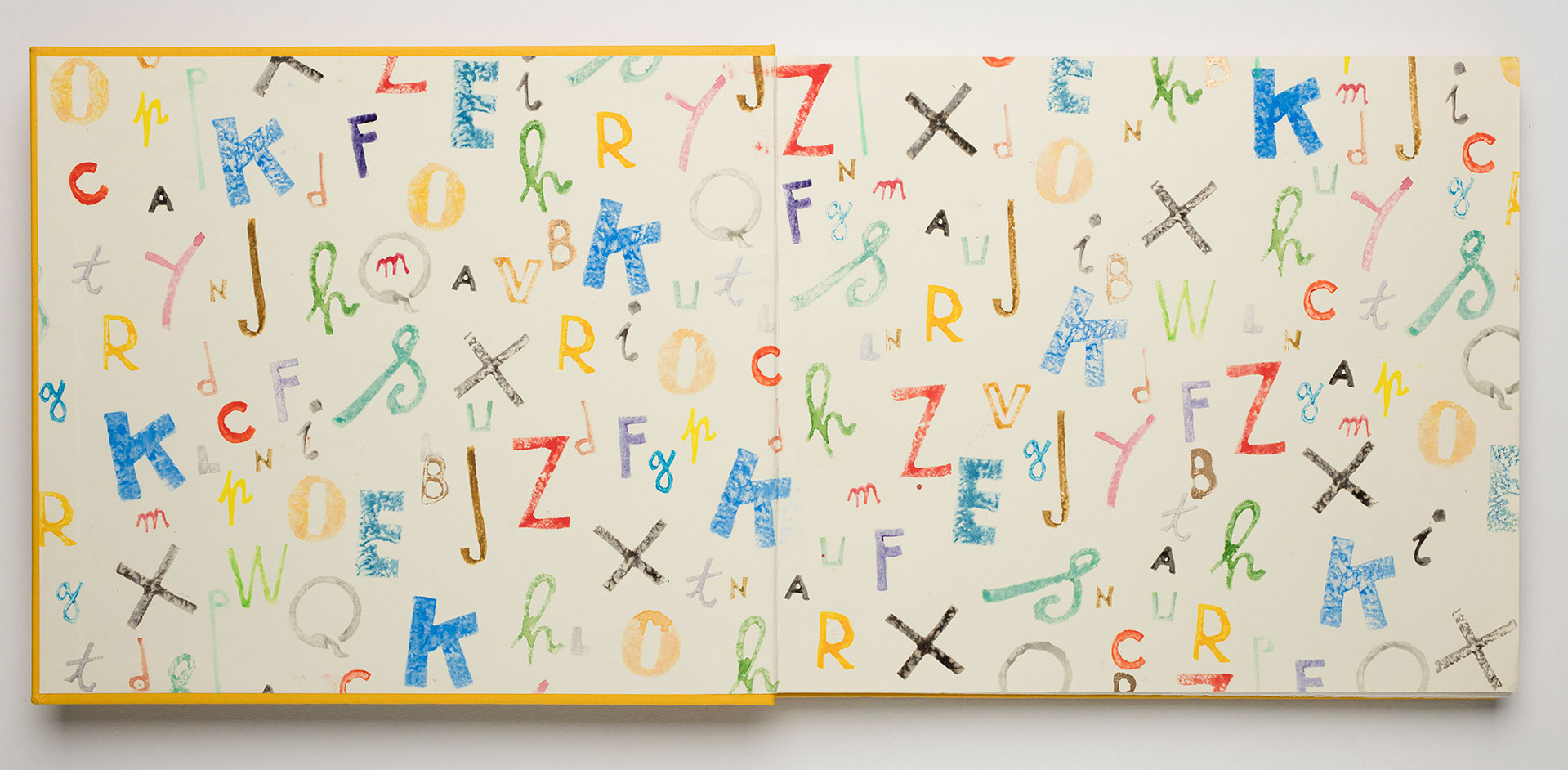 Endpapers with illustrated, colourful letters of the alphabet in various styles.