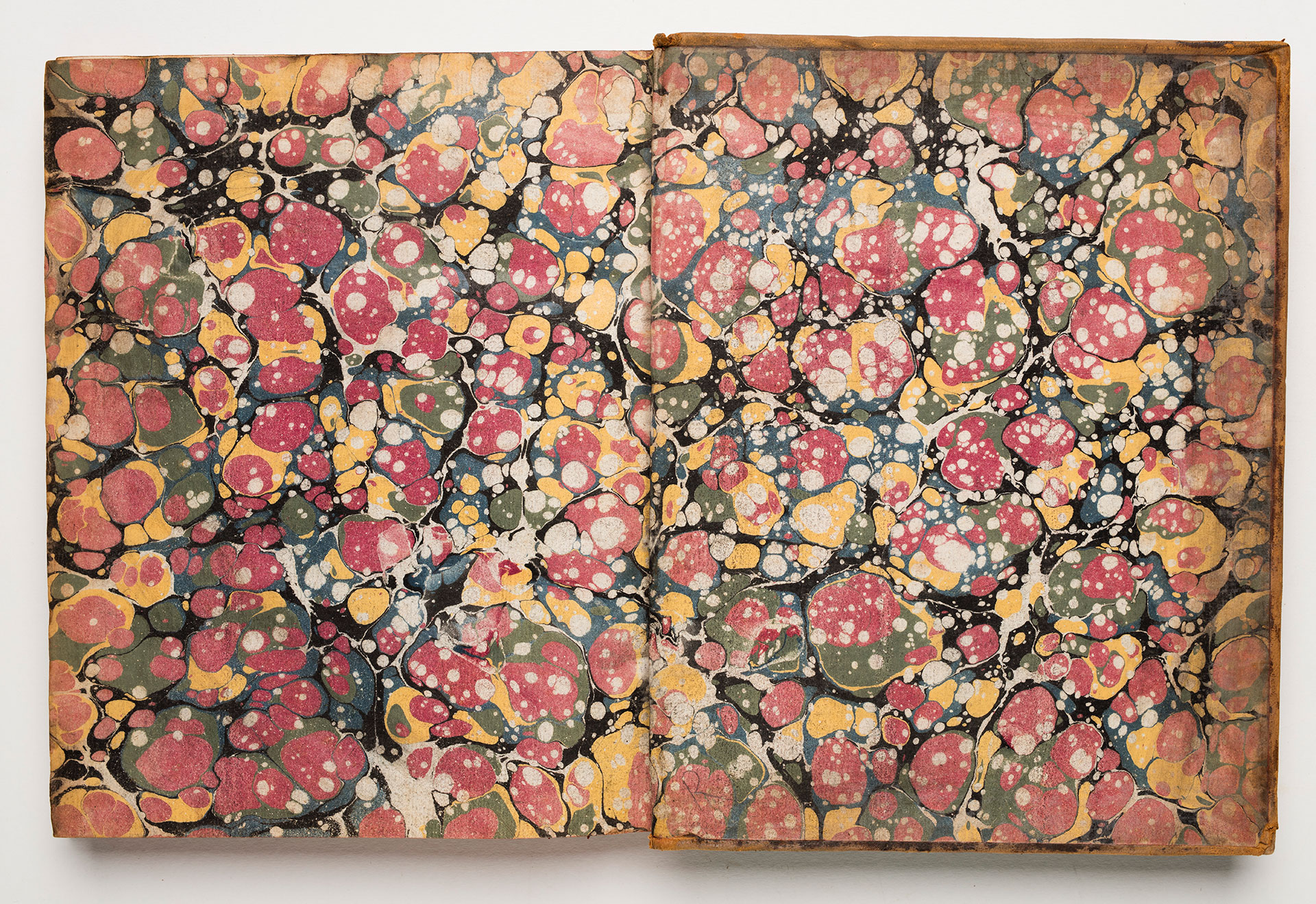 Endpapers with a colourful marbled pattern.