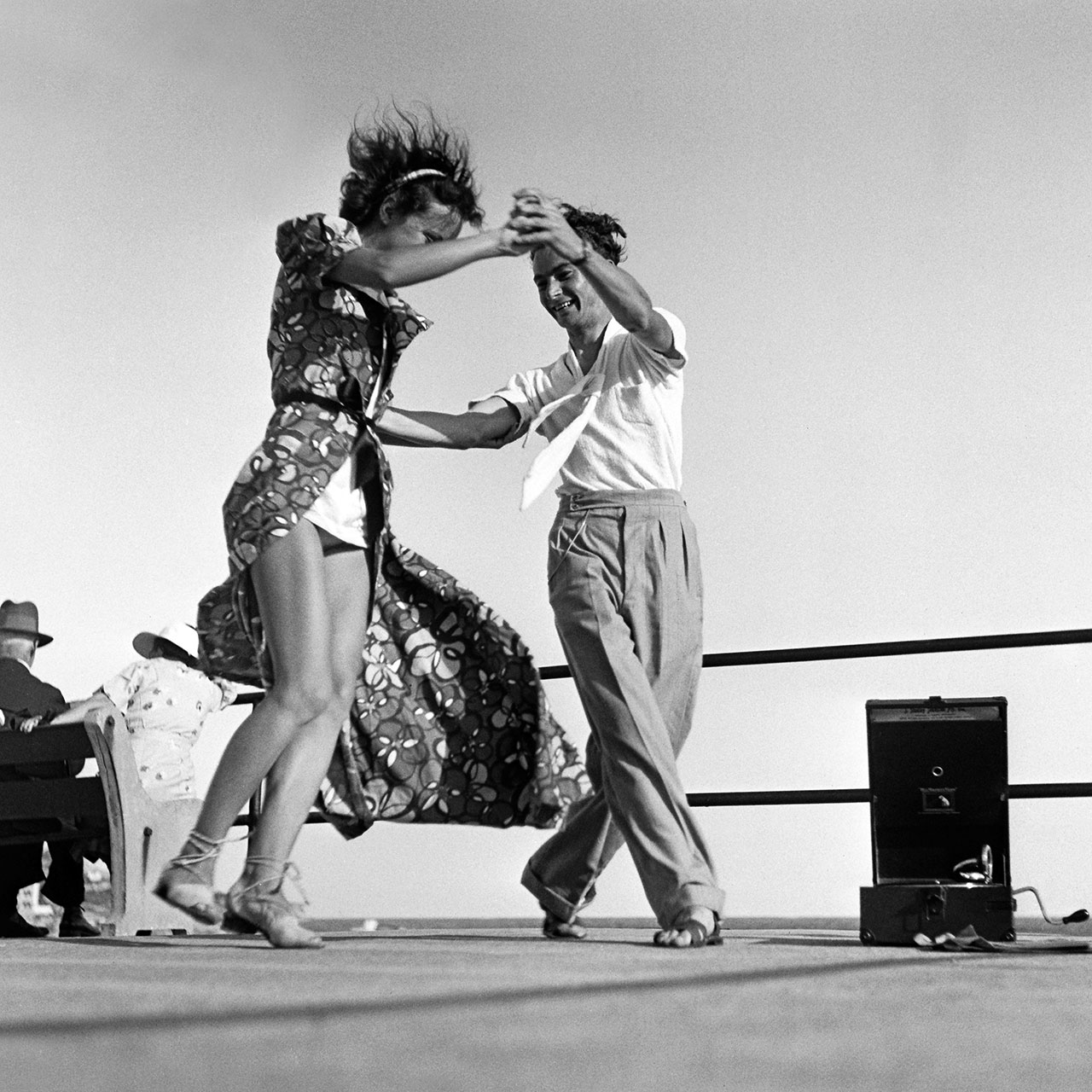 George Caddy dancing with unidentified woman to a portable gramophone, 20 January 1940. (Digital ID: a2391042)