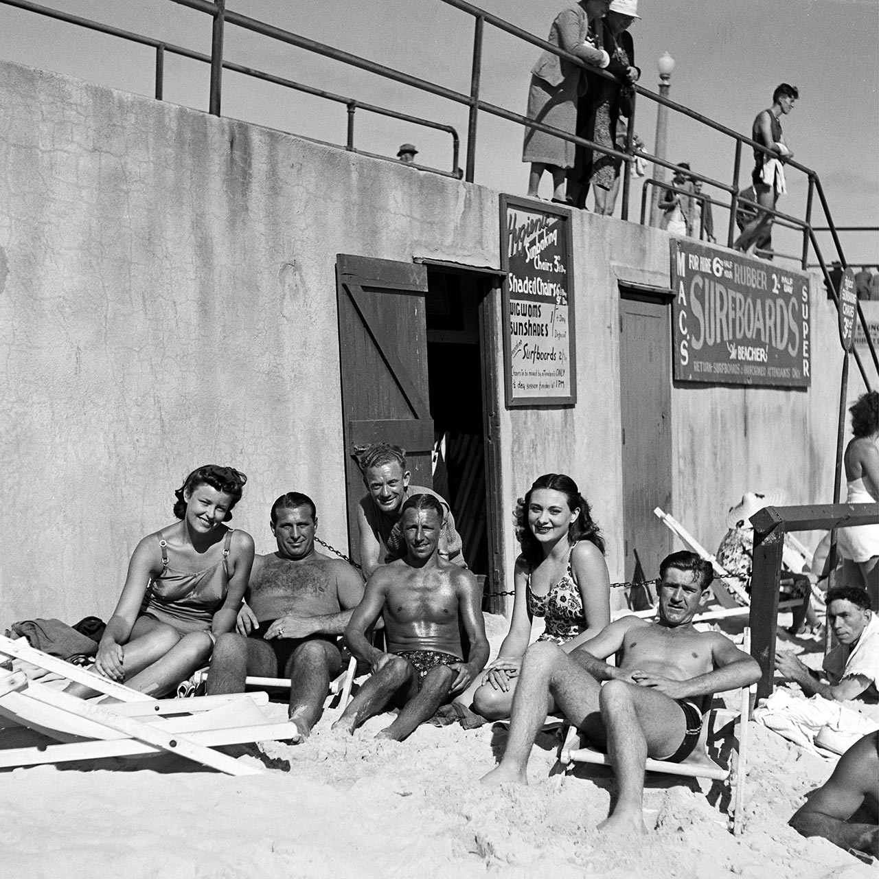 Sunbathing under the promenade, 6 October 1940. (Digital ID: a2391053)