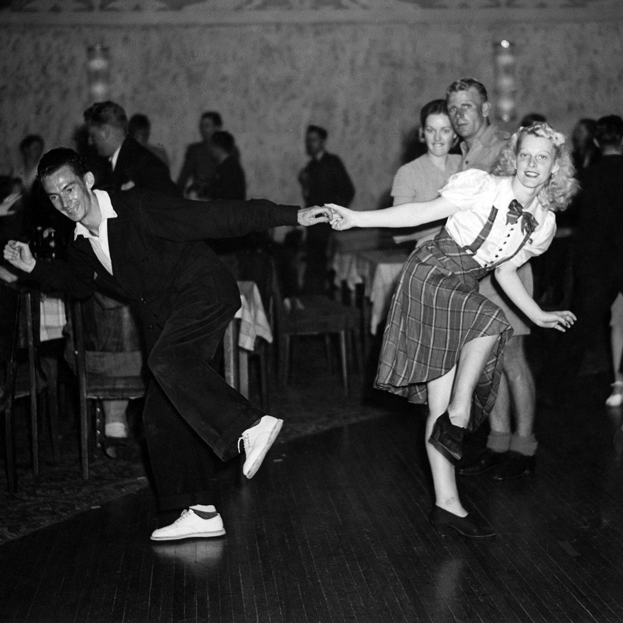 George and champion dancer Mavis Lang jitterbug, Trocadero, 16 March 1941. (Digital ID: a2391058)