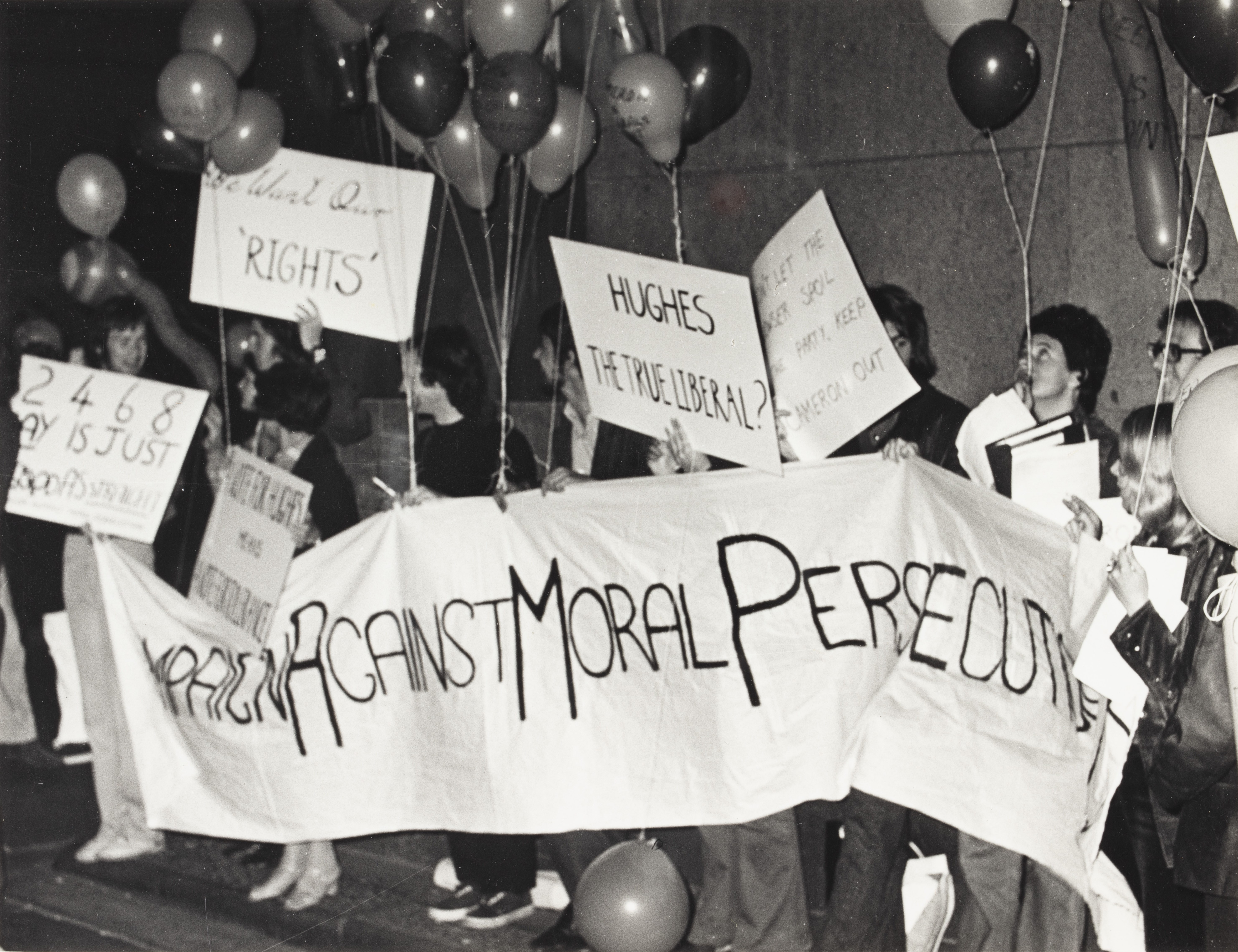 Banner: 'Campaign Against Moral Persecution' & balloons, CAMP Inc. demonstration outside NSW Liberal Party Headquarters, Ash St, Sydney.