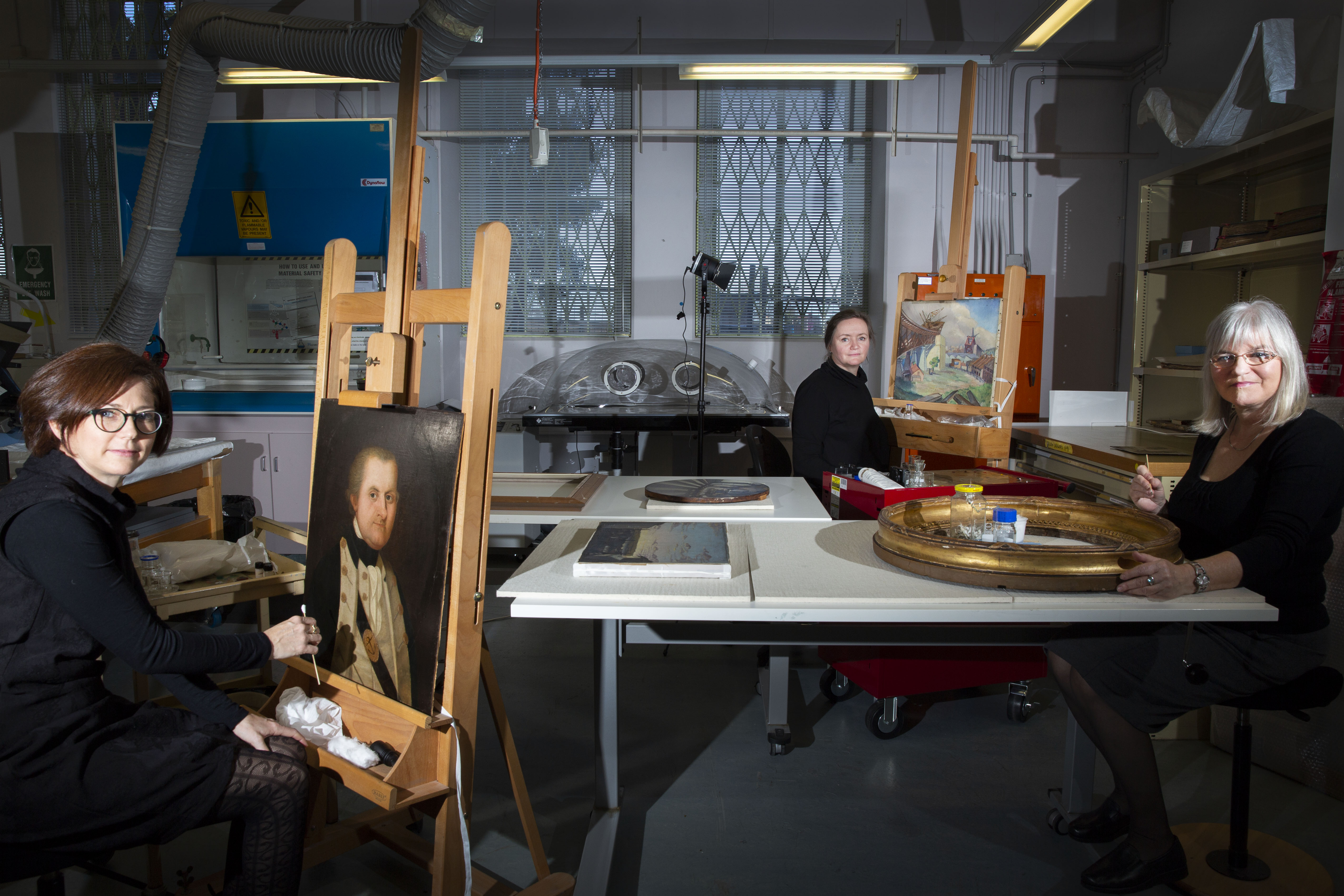 Conservators Andrea Nottage, Michelle Wassall and Basia Dabrowa in the Collection Care lab, photo by Joy Lai
