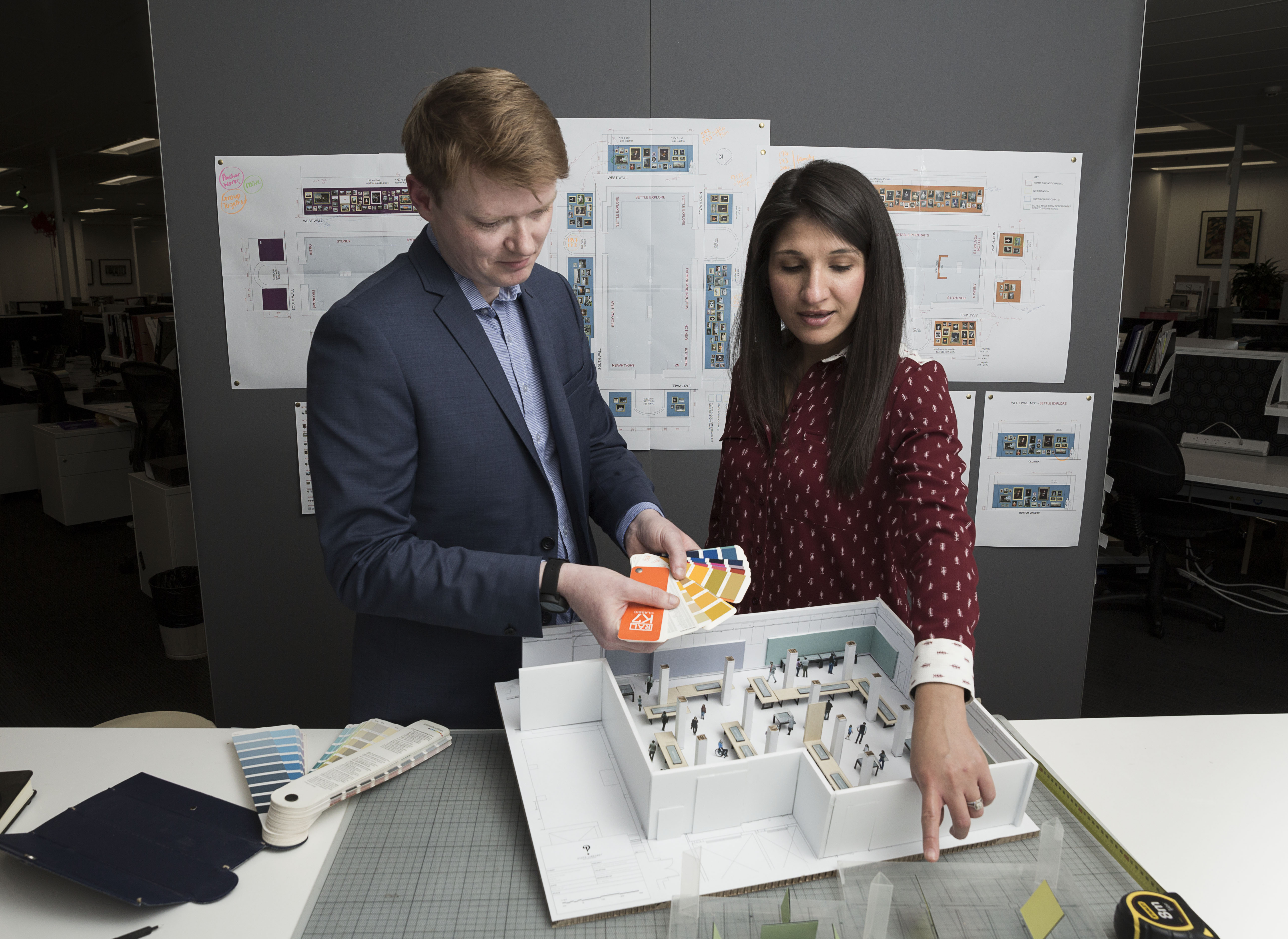 Exhibition designer Paul Bewley and Manager of Exhibitions Rawiya Jenkins with a scale-model of the UNESCO Six exhibition, photo by Zoe Burrell
