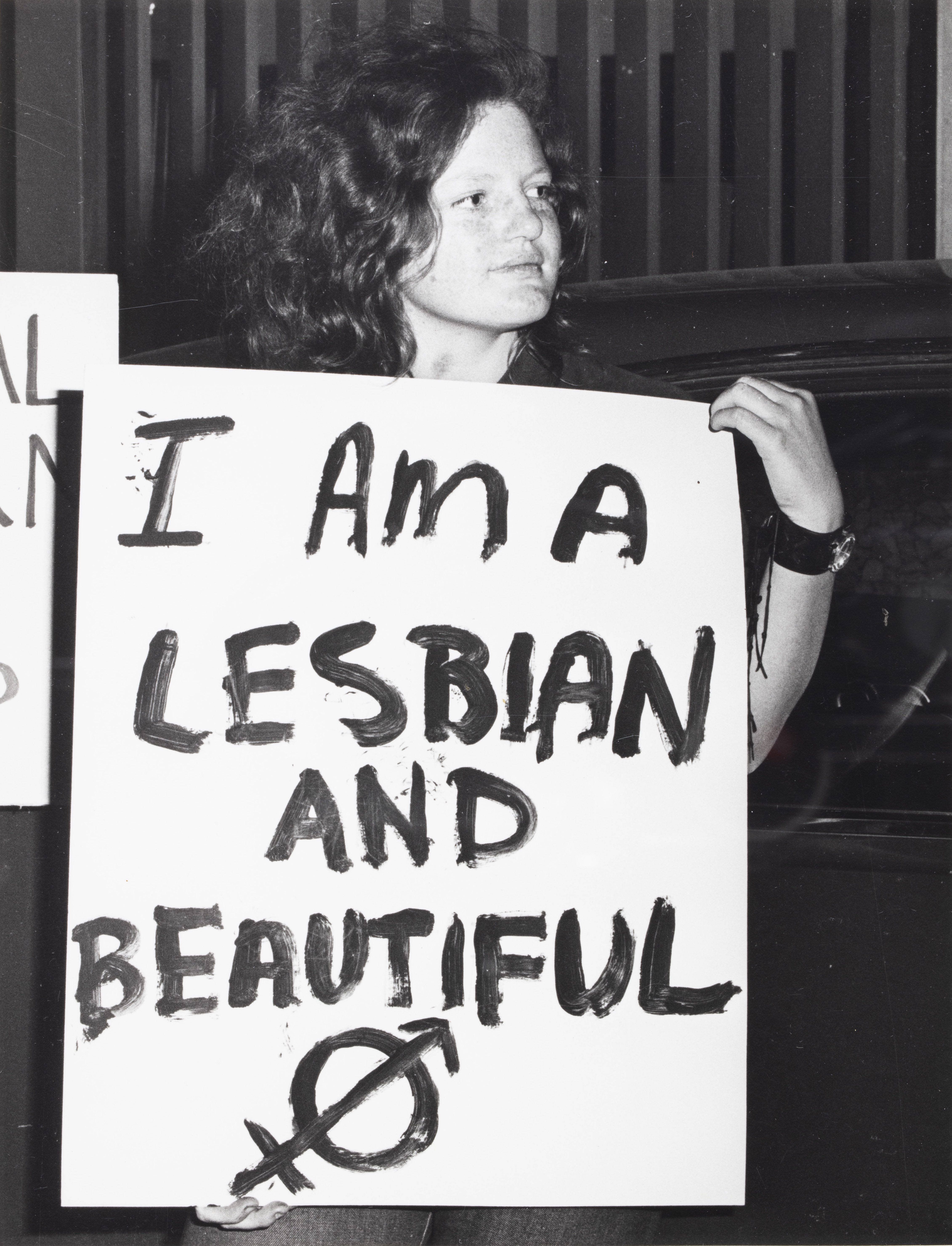 Placard: 'I am a Lesbian & Beautiful', CAMP Inc. demonstration outside NSW Liberal Party Headquarters, Ash St, Sydney.