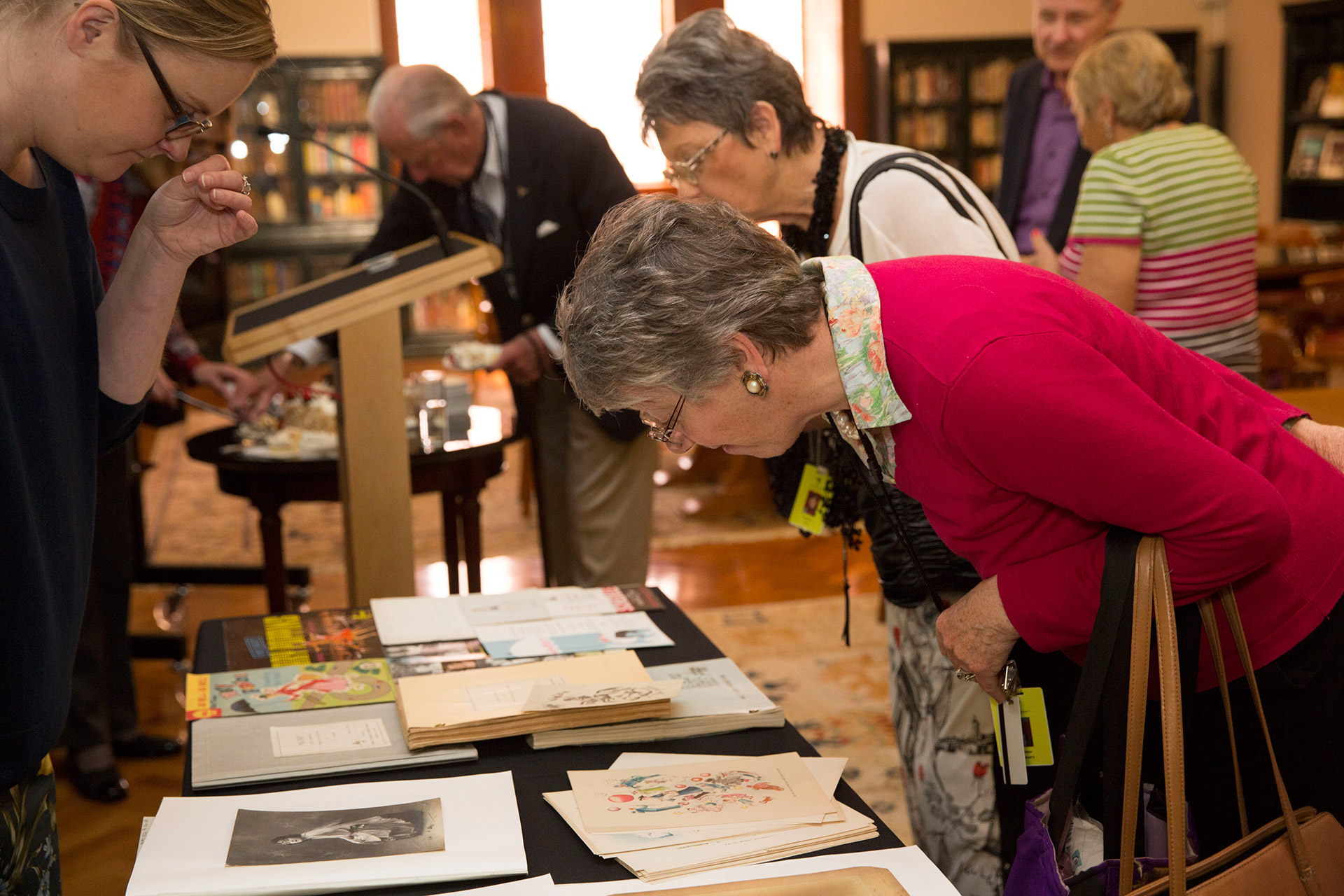 Woman looking at collection items