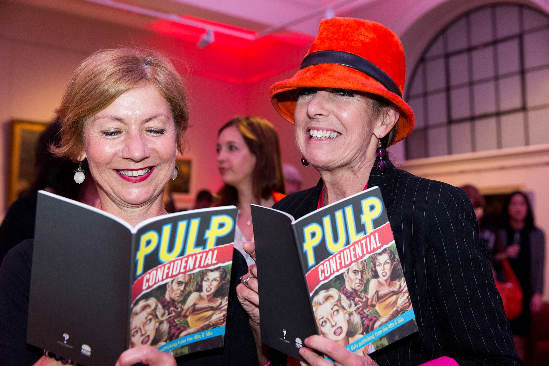 """Two women holding up """"Pulp"""" books"""