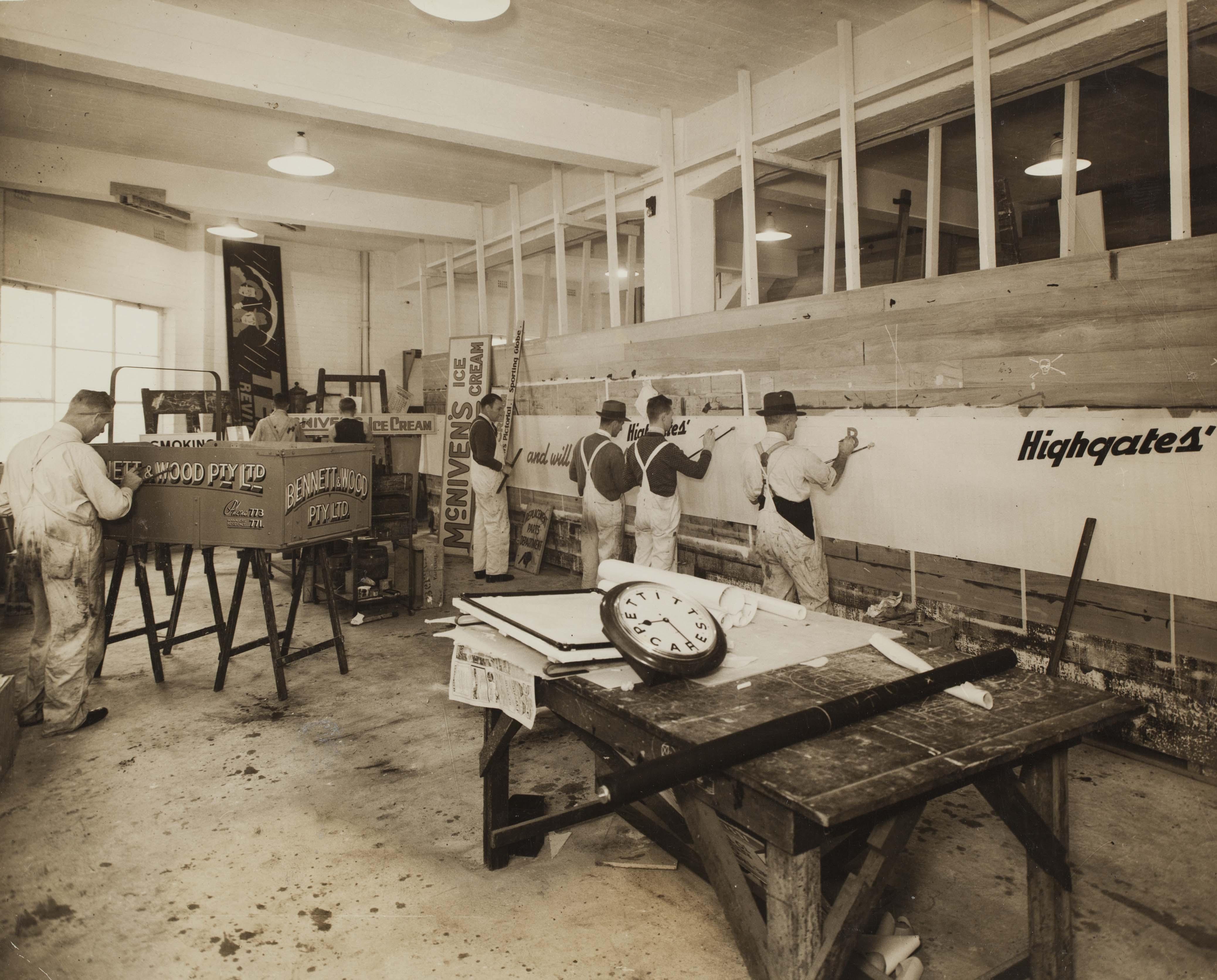 Men painting studio walls