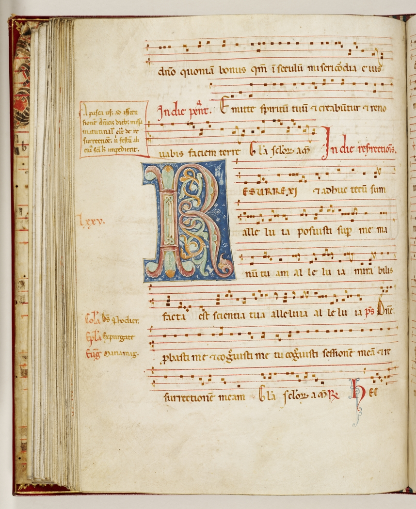 Page of an old book with ornate music score and large ornate coloured letter R.