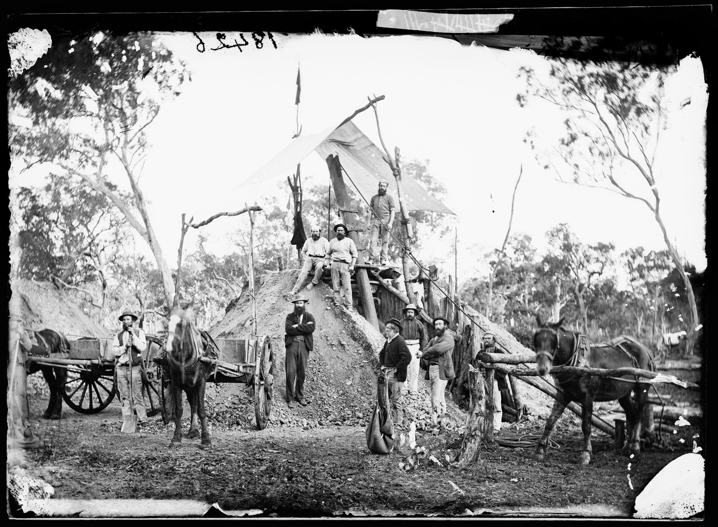 Gold miners on a mine head flying the flag required by law for a gold strike, Home Rule (?)
