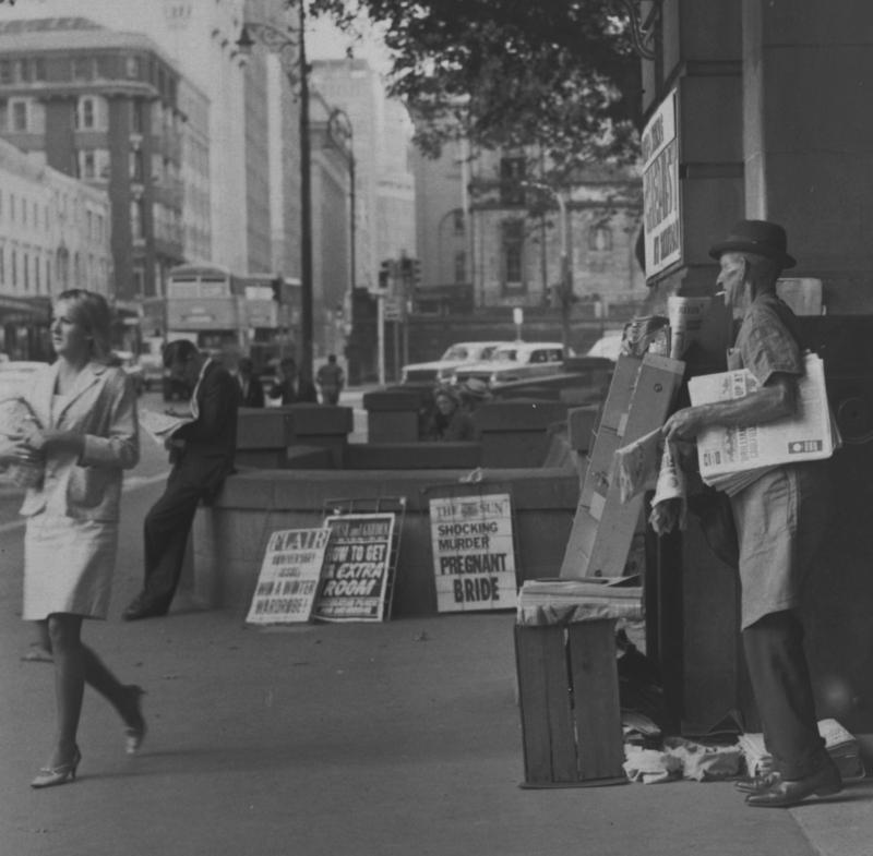 News paper seller, St James Station