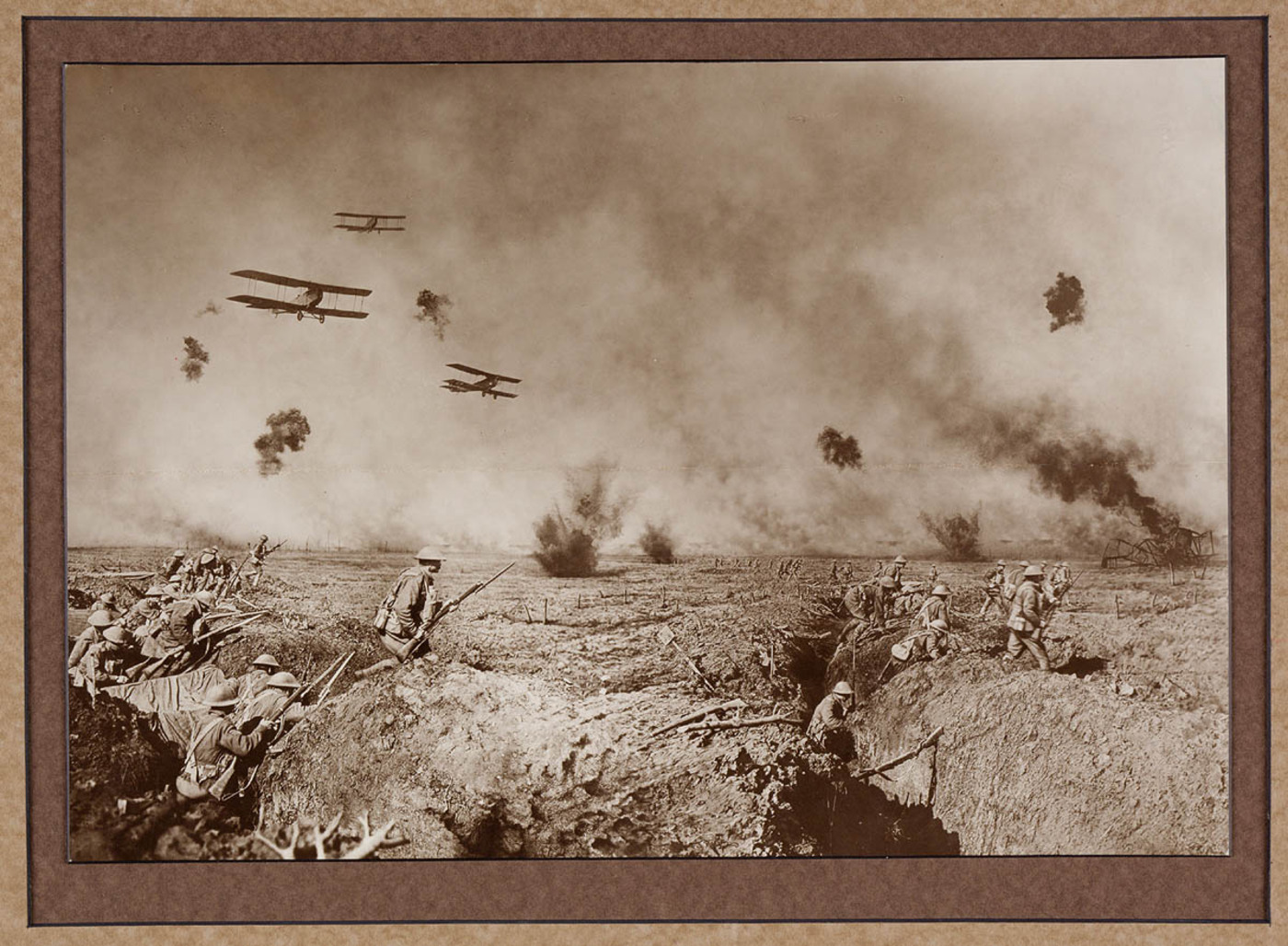 An episode after the Battle of Zonnebeke. Australian Infantry moving forward to resist a counter attack. On the-extreme right a machine brought down in flames is burning fiercely. Our advance is supported by bombing planes...