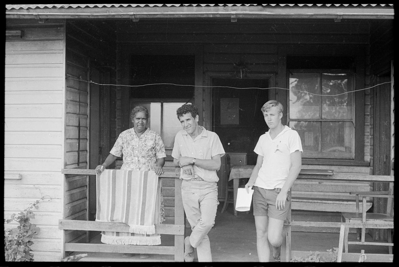 three people on a wood verandah