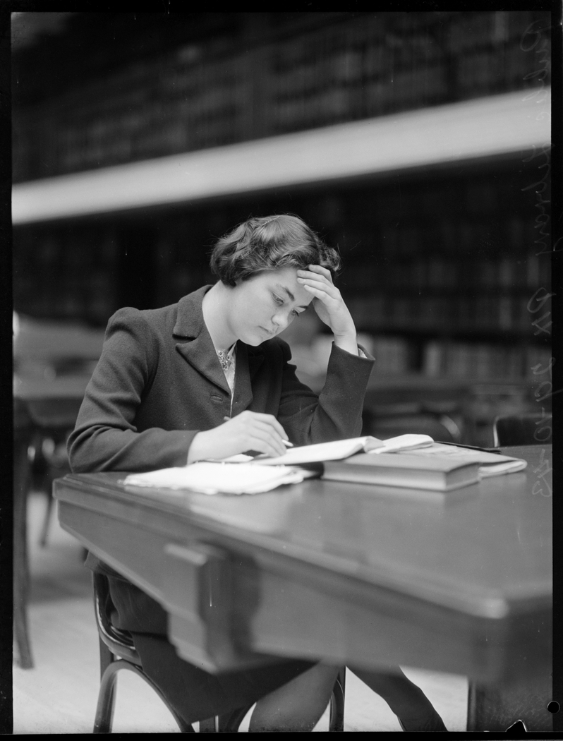 Woman sitting at desk in Reading Room