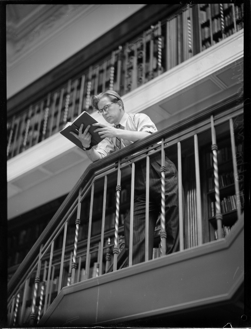 Woman sitting on stairs in Reading Room