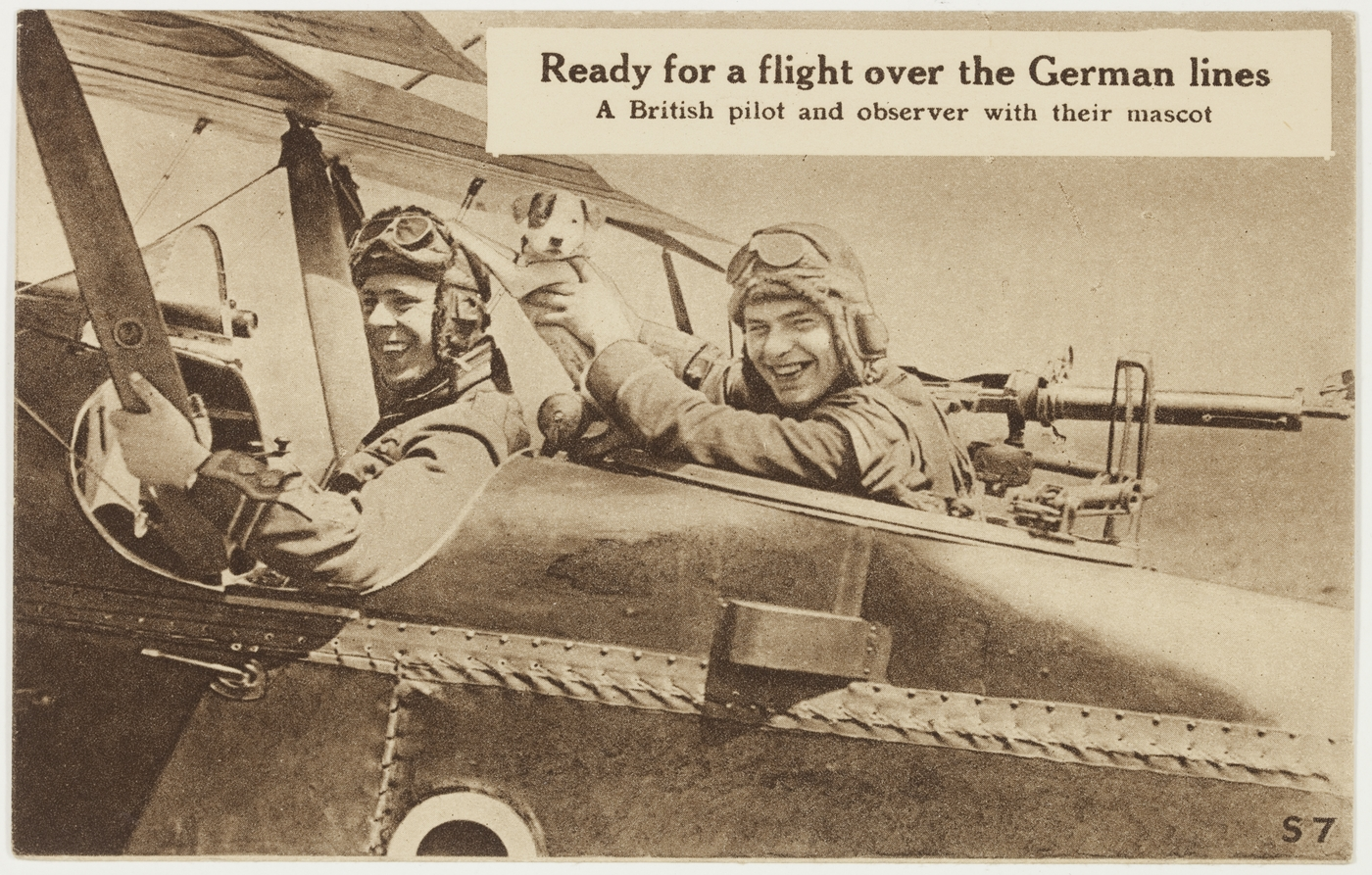Ready for a flight over the German lines - a British pilot and observer with their mascot