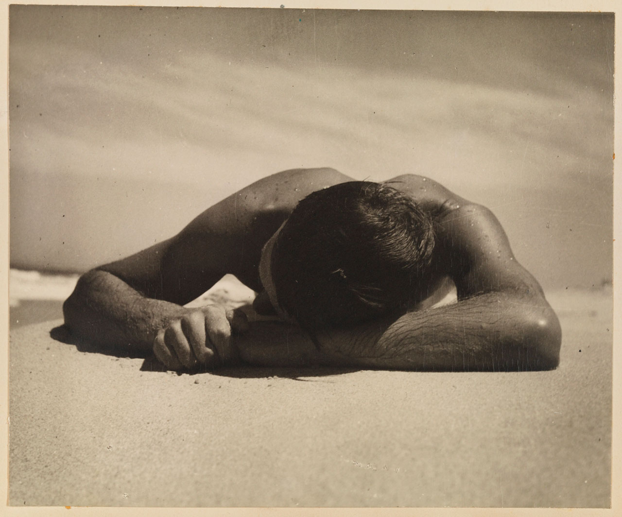 """Camping trips on Culburra Beach, N.S.W., 1937 / Max Dupain and Olive Cotton. 19. Harold Salvage sunbaking, """"The Sunbather"""". SAFE/PXA 1951. (Digital ID: a9668019)"""