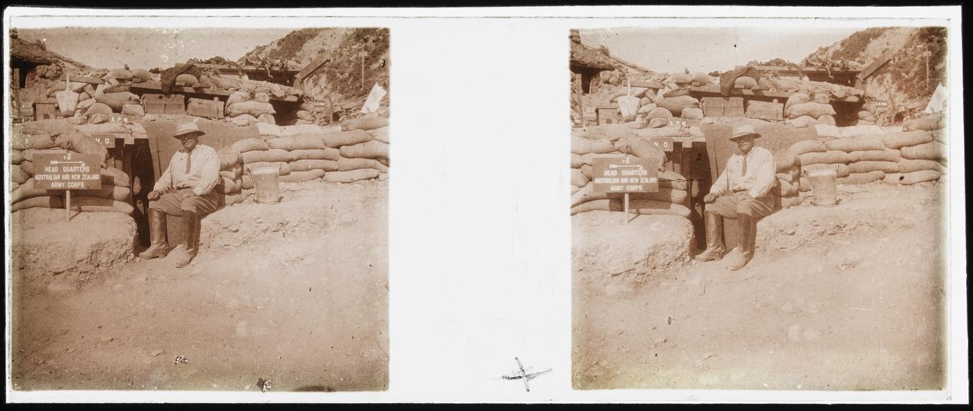 Surgeon Charles S. Ryan sitting outside his dugout, Gallipoli