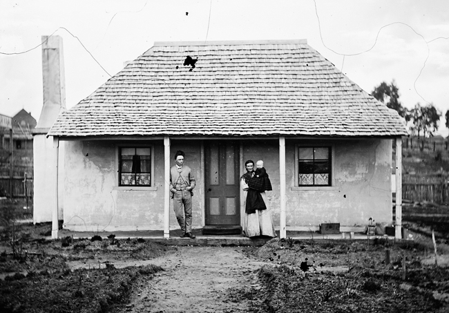 Mark Hammond with his wife Mary outside their four room cottage in Tambaroora St., Hill End, 1872