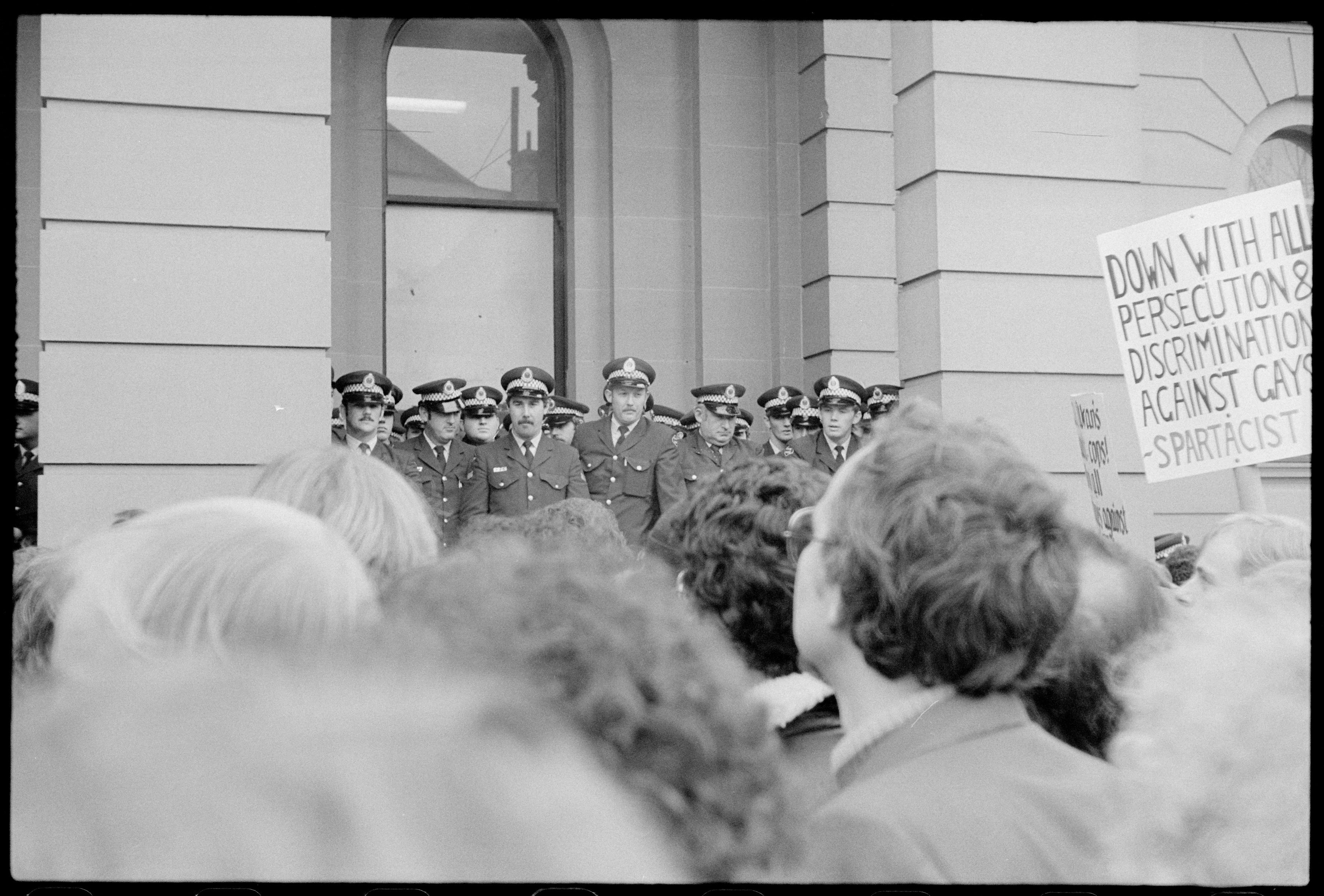 Placard: 'Down With All Persecution & Discrimination Against Gays - Spartacist', Gay Rights demonstration outside Central Police Court, Liverpool St, Sydney. Tribune Collection. NB: neg flipped