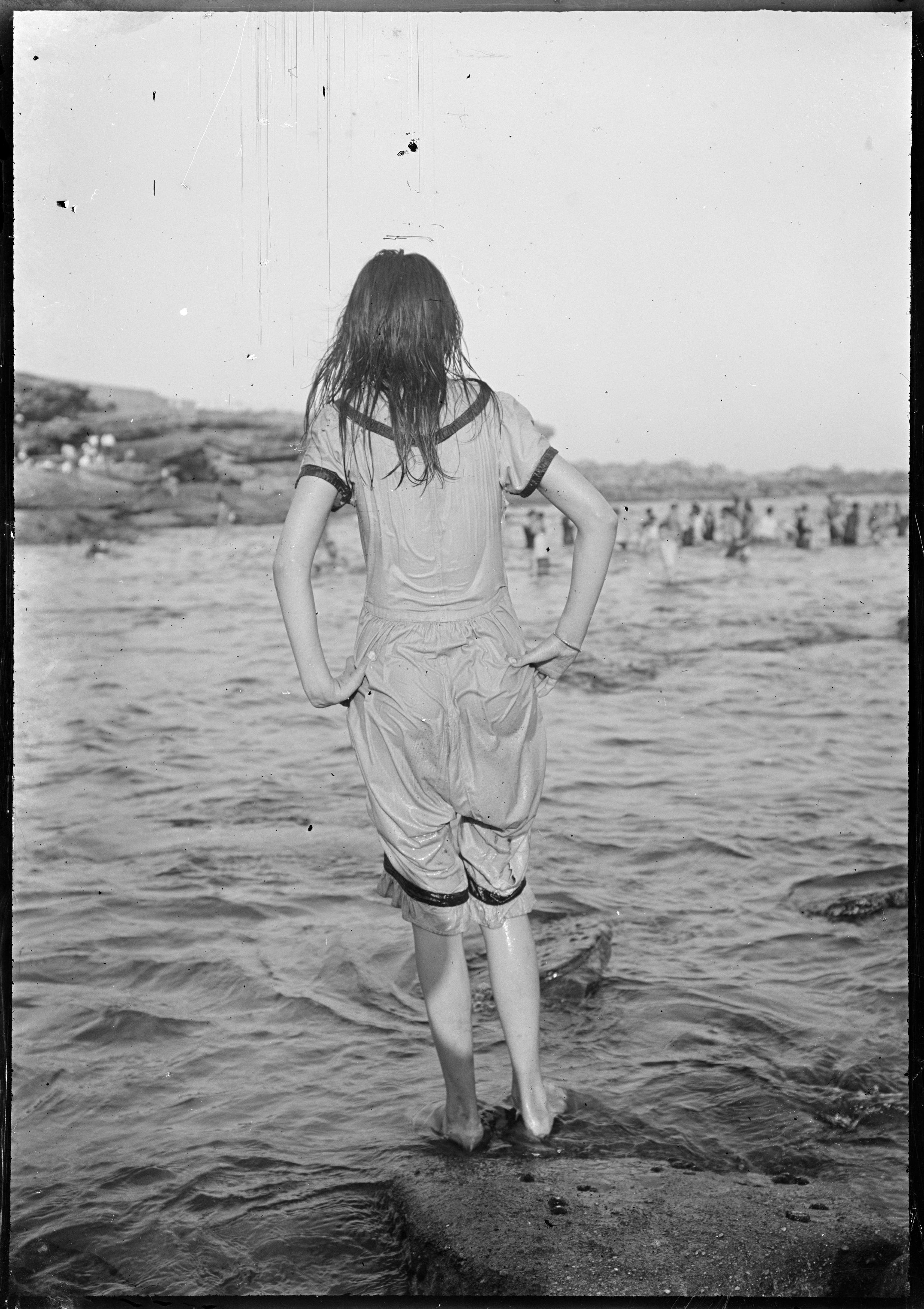 Girl in wet swimsuit at Clovelly