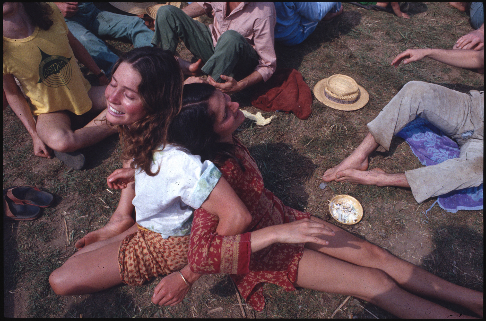 Two women embracing at a festival
