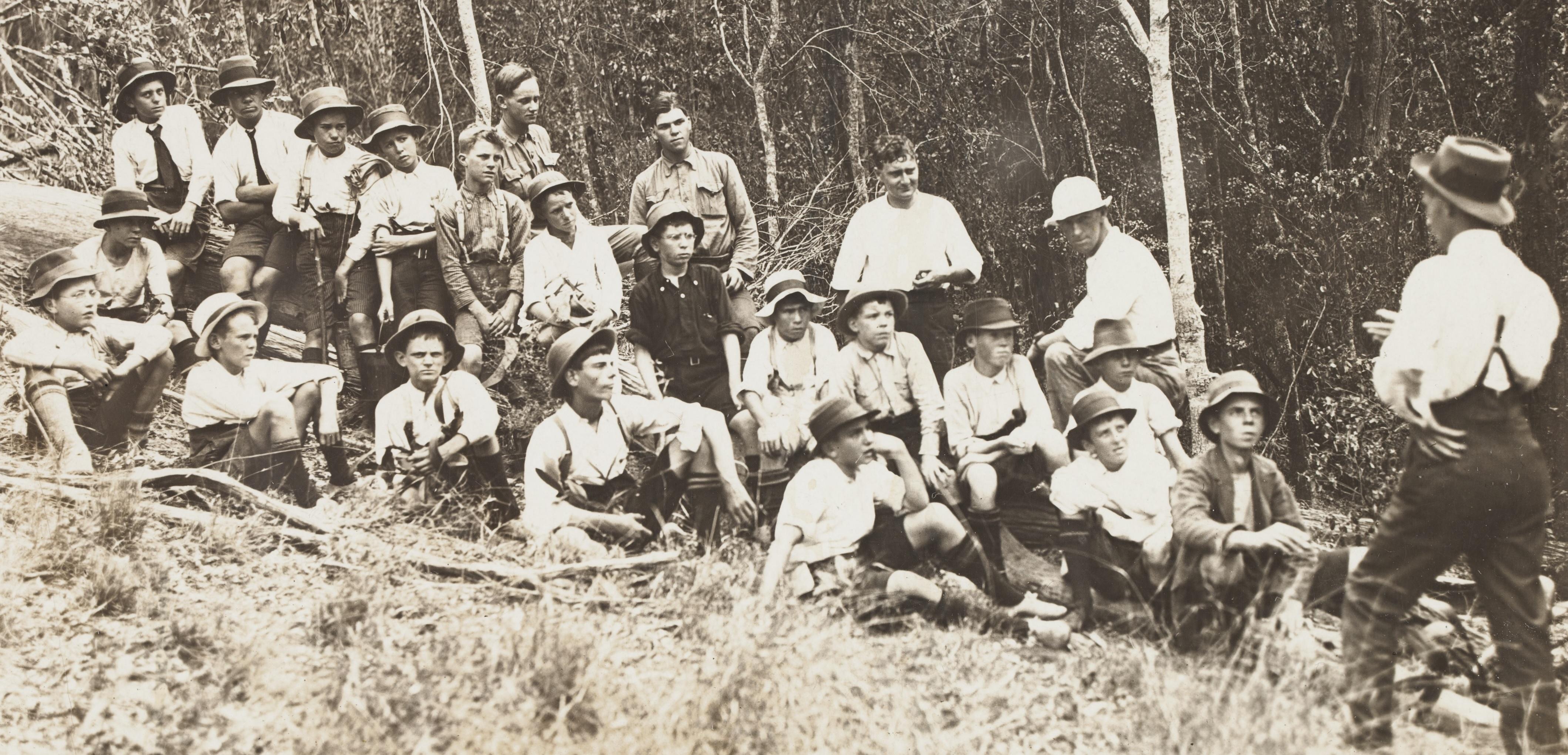 Chisholm teaching bush boys about the birds, ca.1914'