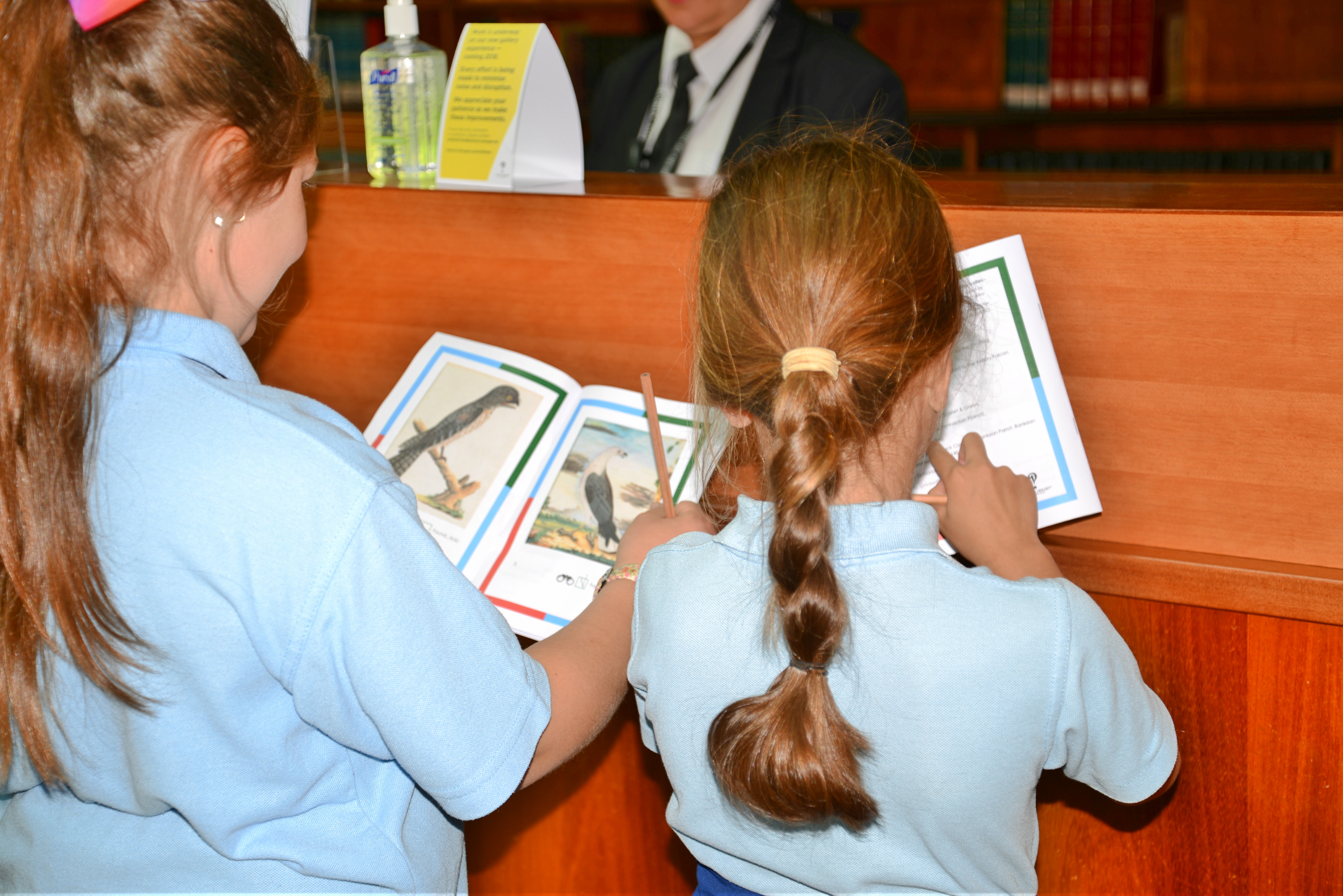 two students completing a notebook