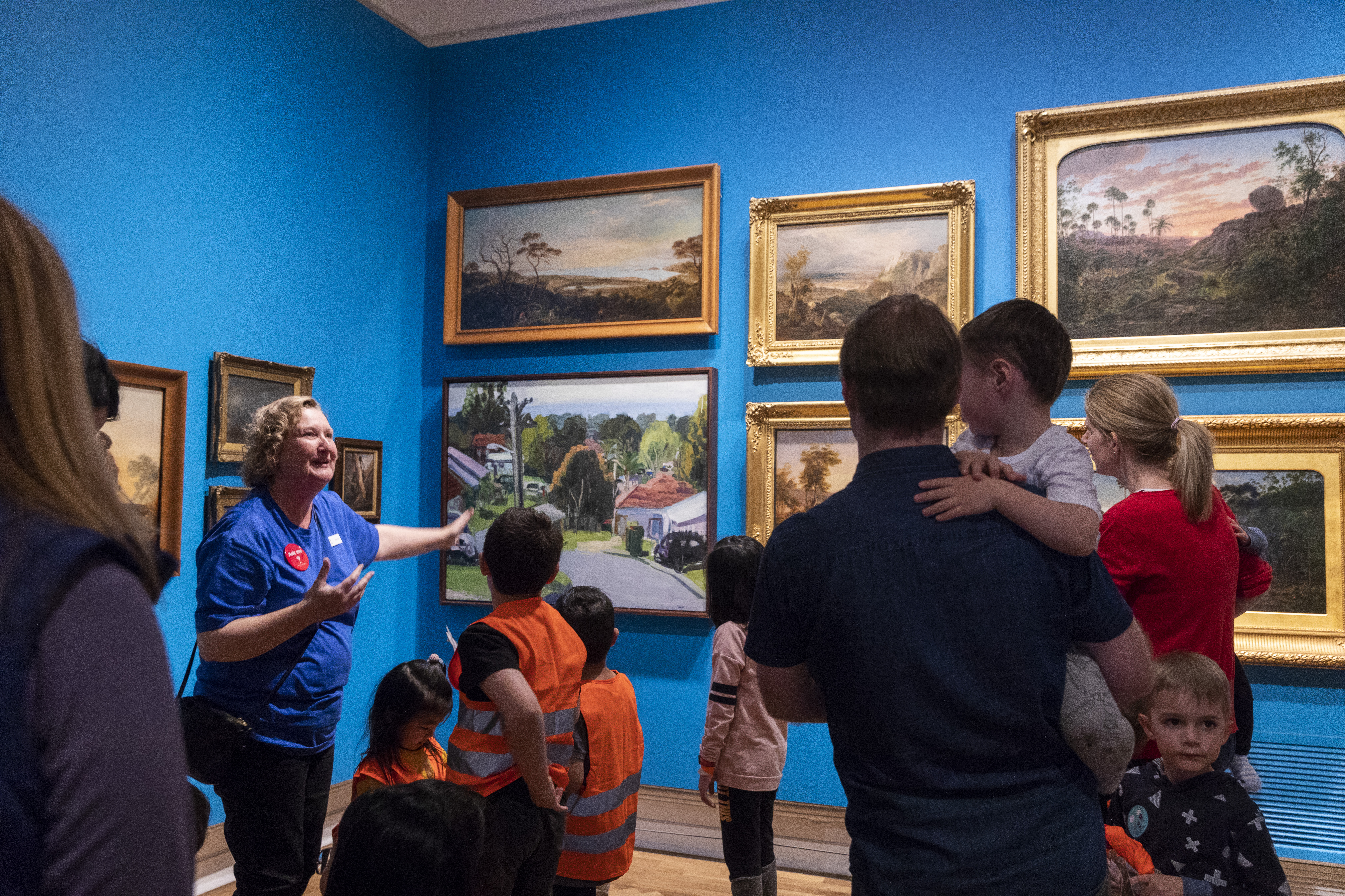 Children and parents on a tour of the paintings gallery