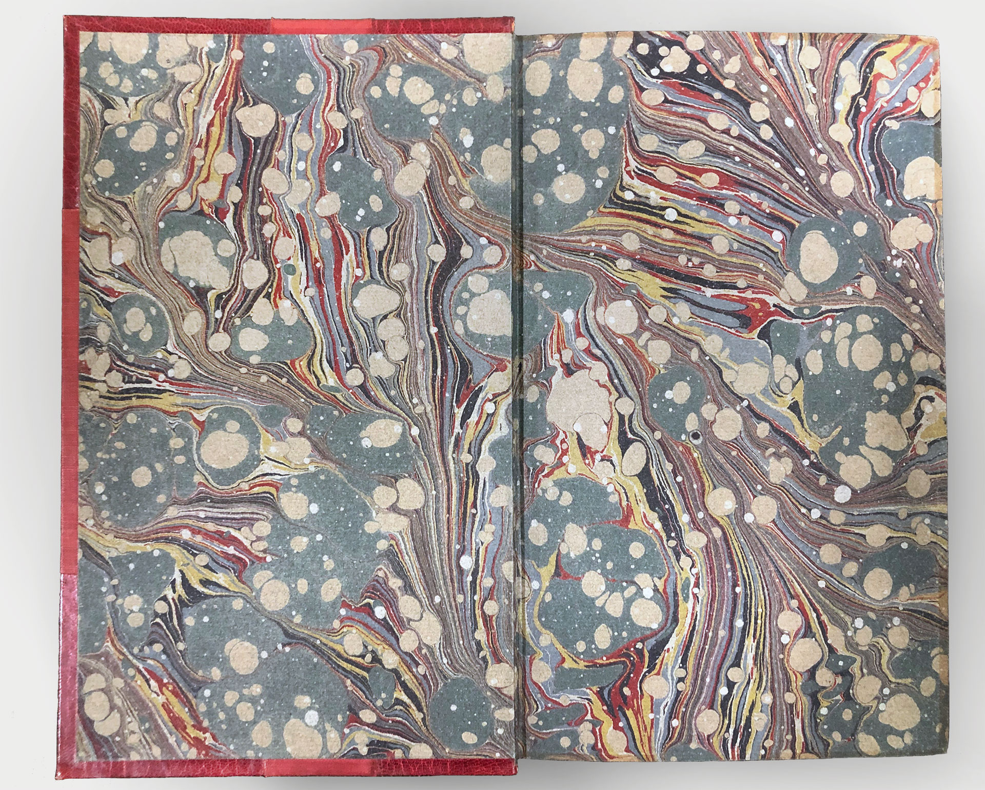 Endpapers with a colourful but dimmed marbled pattern.