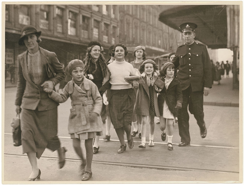Crossing the road, c. 1935, by Sam Hood, Silver gelatin photoprint, PXE 789/11/34