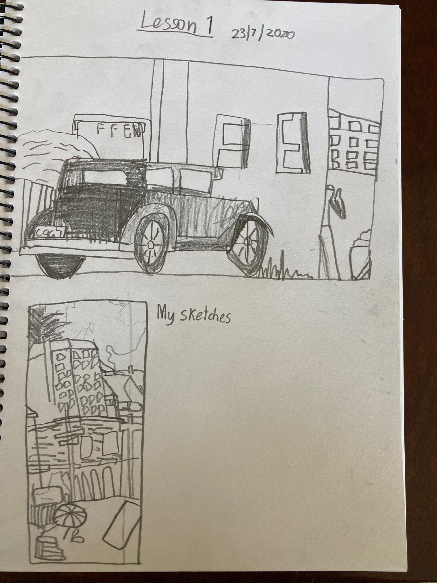 A drawing created by an Art Club member of a car and some buildings.