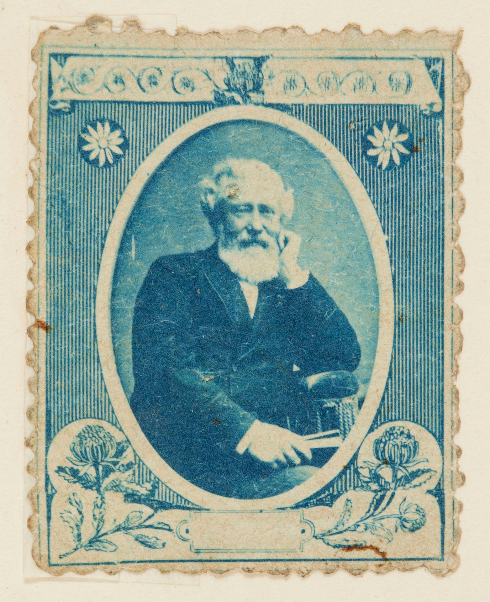 An old blue stamp with a portrait of a bearded man.