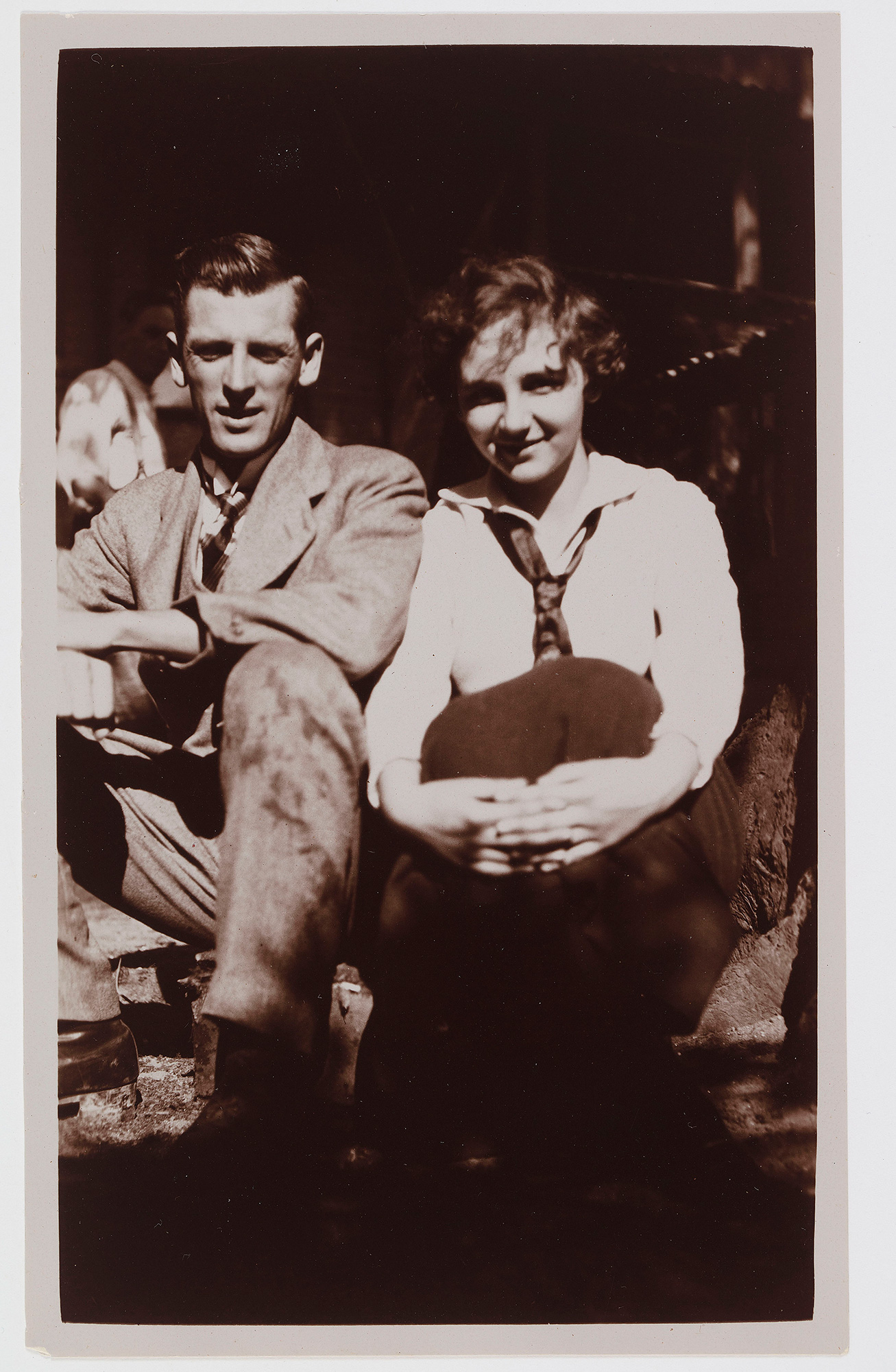 A black and white photograph of a man and a woman.