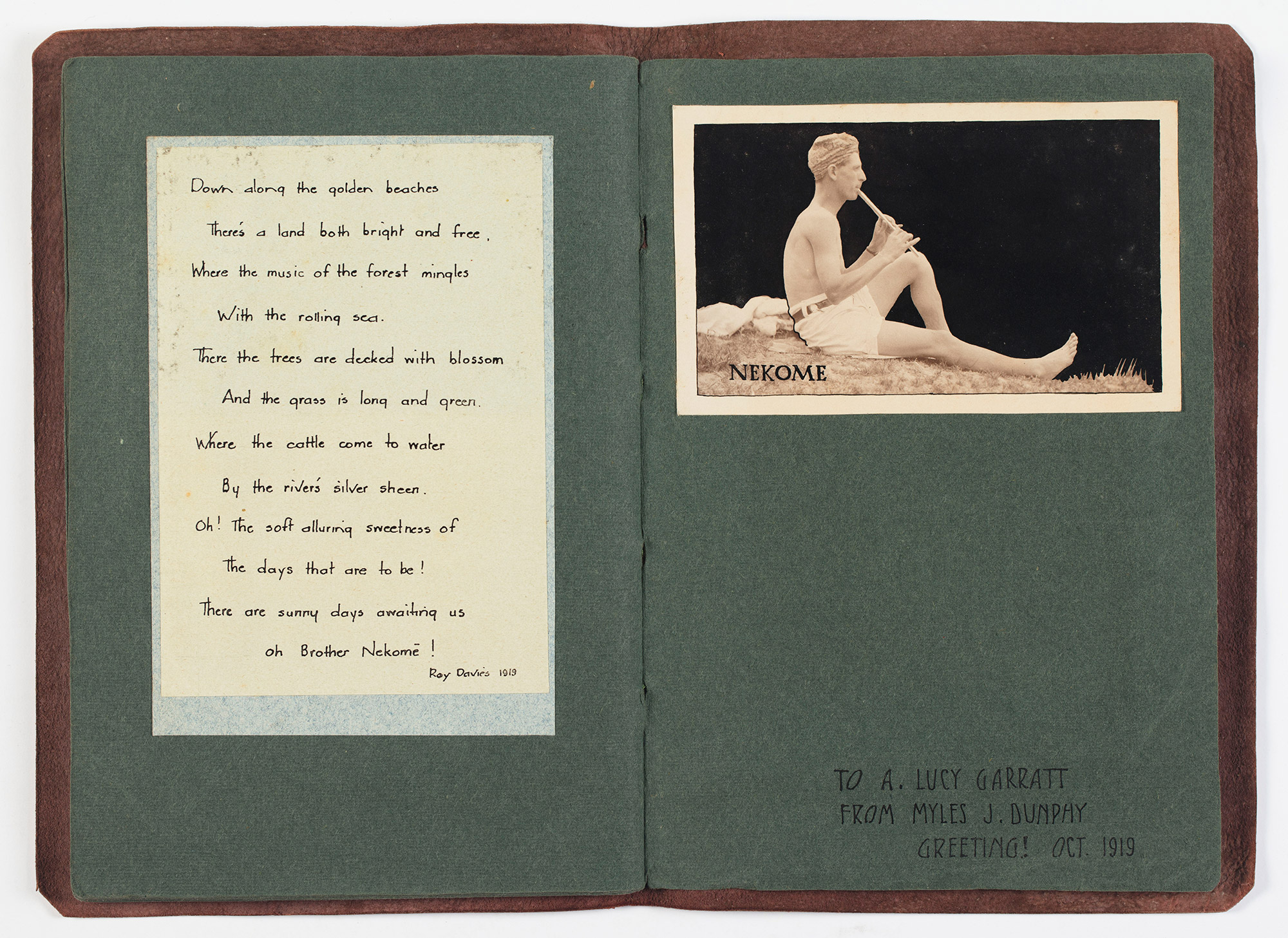 An open booklet featuring a handwritten poem and a photo of a man playing a flute.