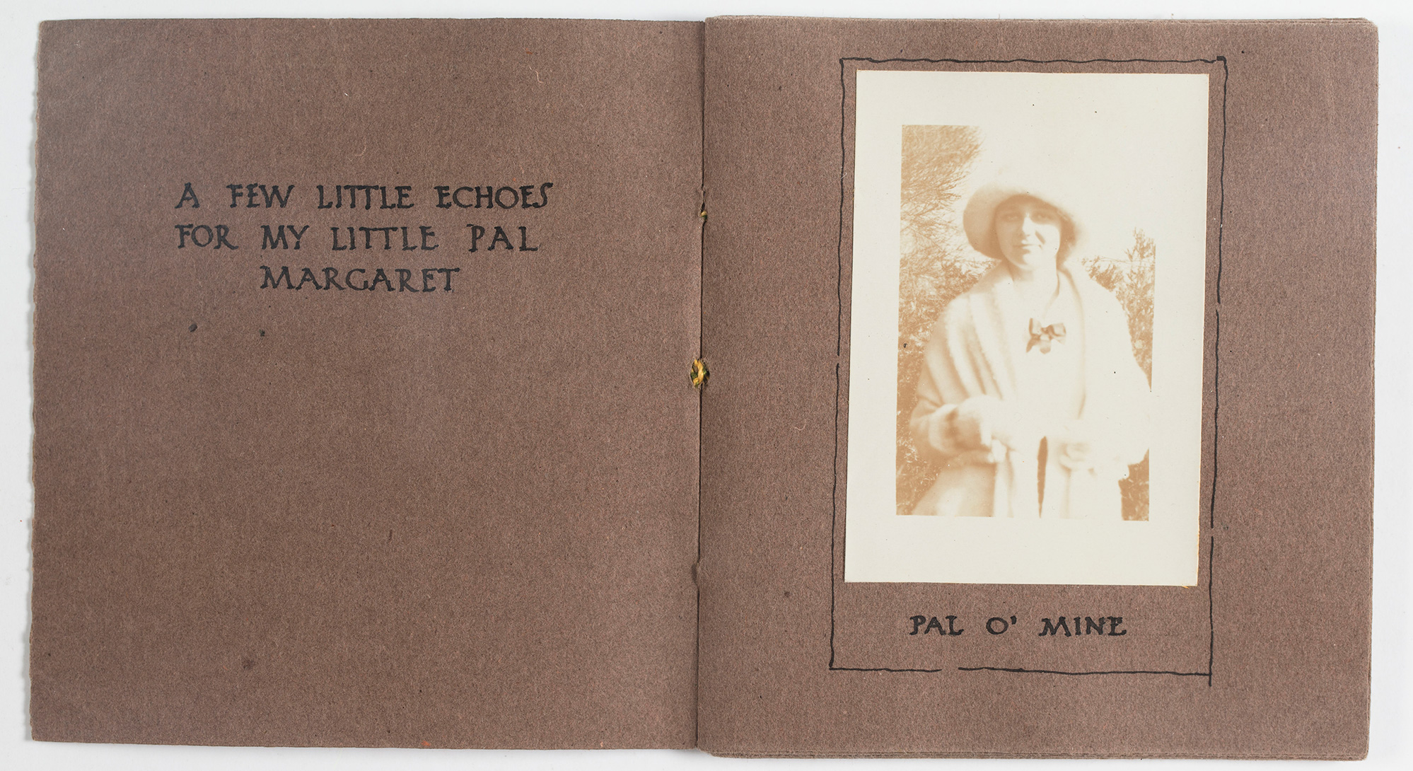 Hand-bound book open to a page with a photograph of a woman.