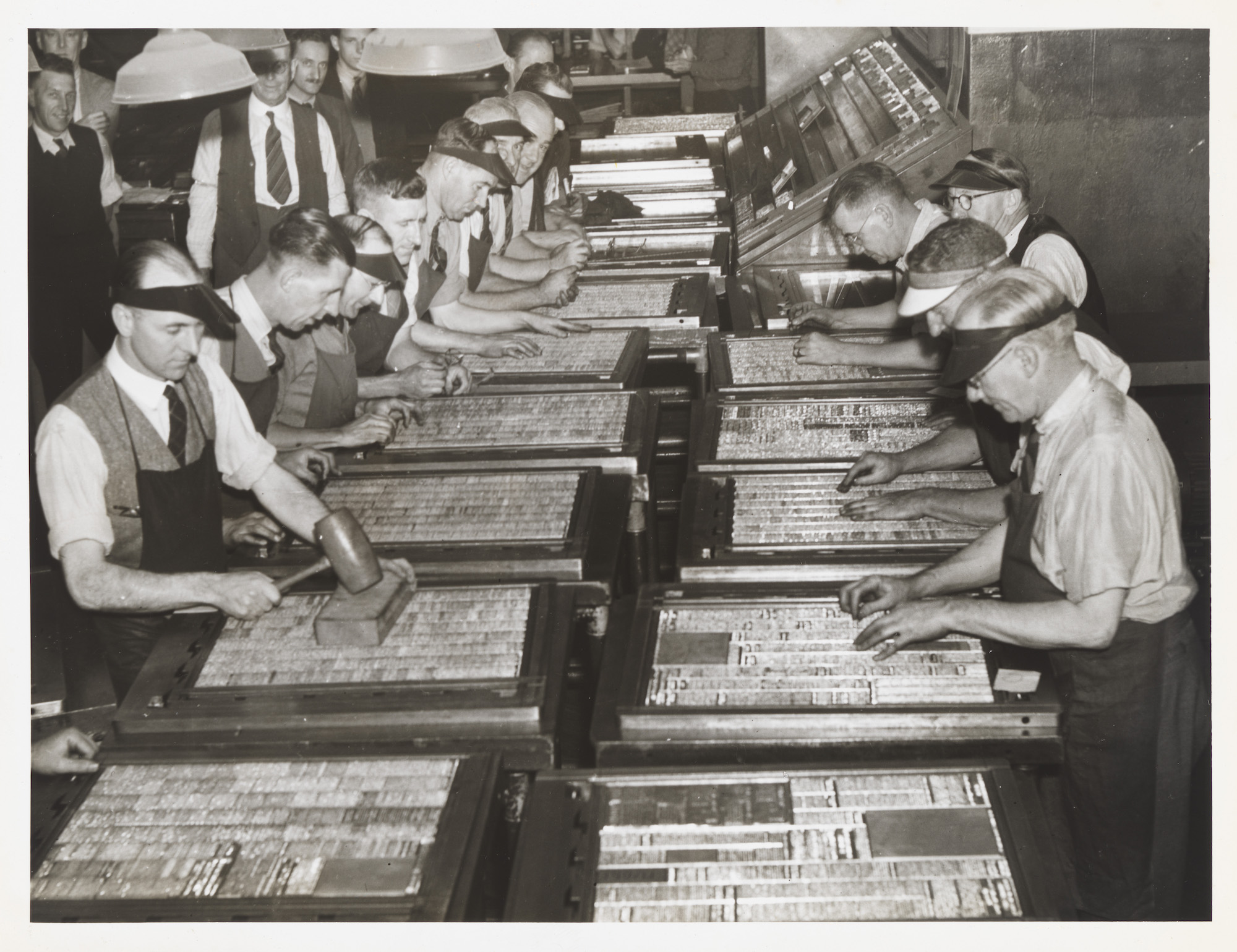 Sydney Morning Herald typesetters preparing the paper, with news rather than advertisements appearing on the front page for the first time, 1944