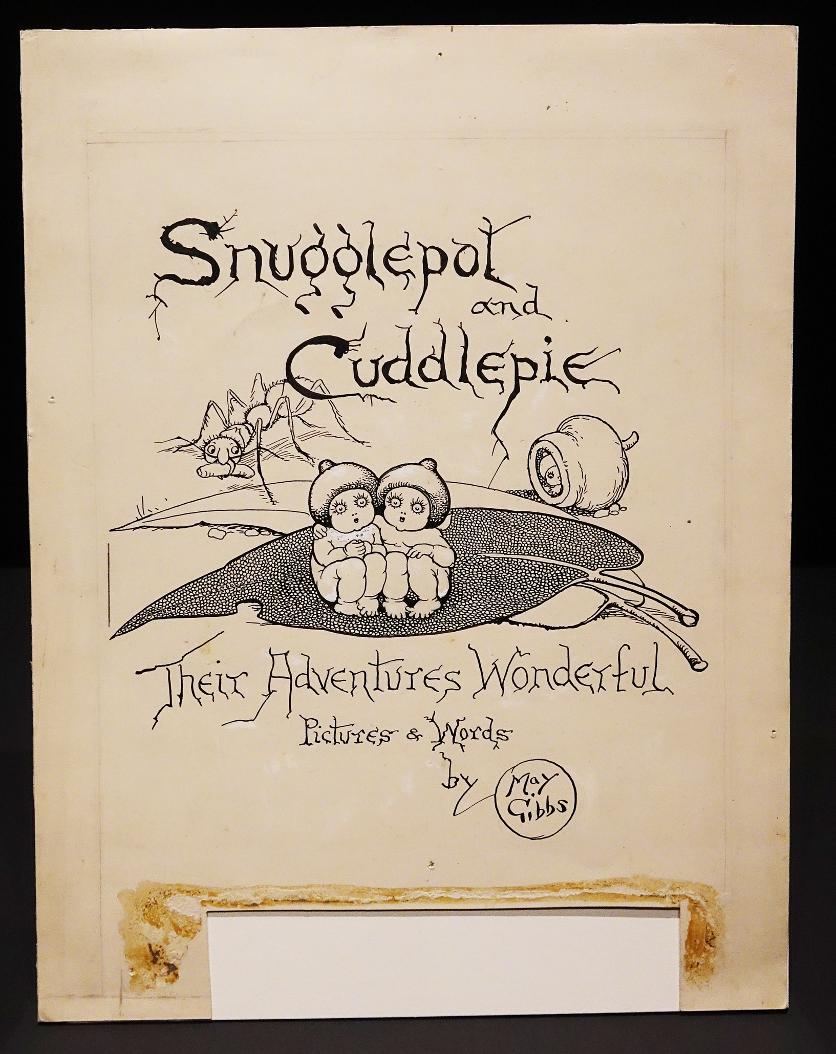 Drawing of title page for Snugglepot and Cuddlepie featuring an image of two miniature babies with gumnut hats sitting on a gum leaf.