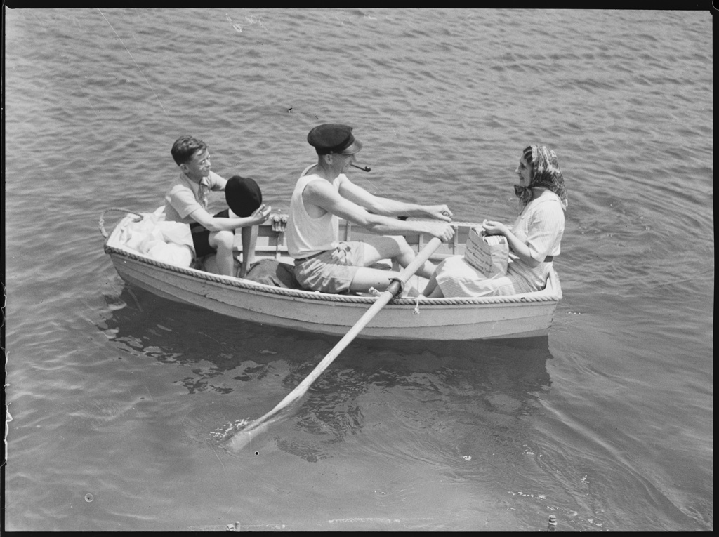 Man, woman and child in a row boat