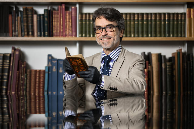 Christopher Allen with Persian manuscript