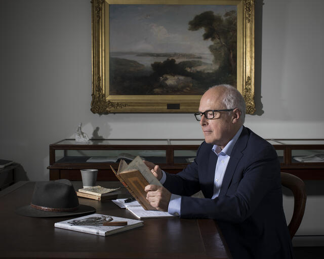 Dr John Vallance Reading in his Office