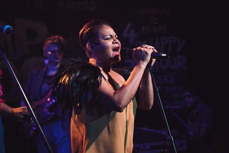 Woman with microphone on stage.