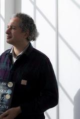 Dr Omid Tofighian with Behrouz Boochani's book