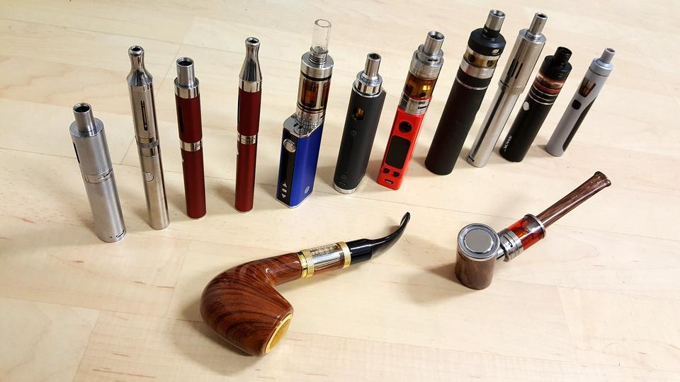A collection of e-cigarette vape pens of different sizes and shapes