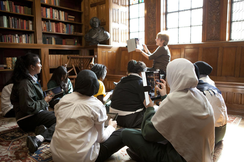 Students sitting in the State Library Shakespeare Room looking at iPads