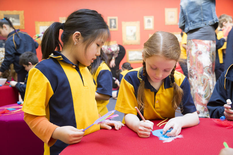two girls participating in craft activity