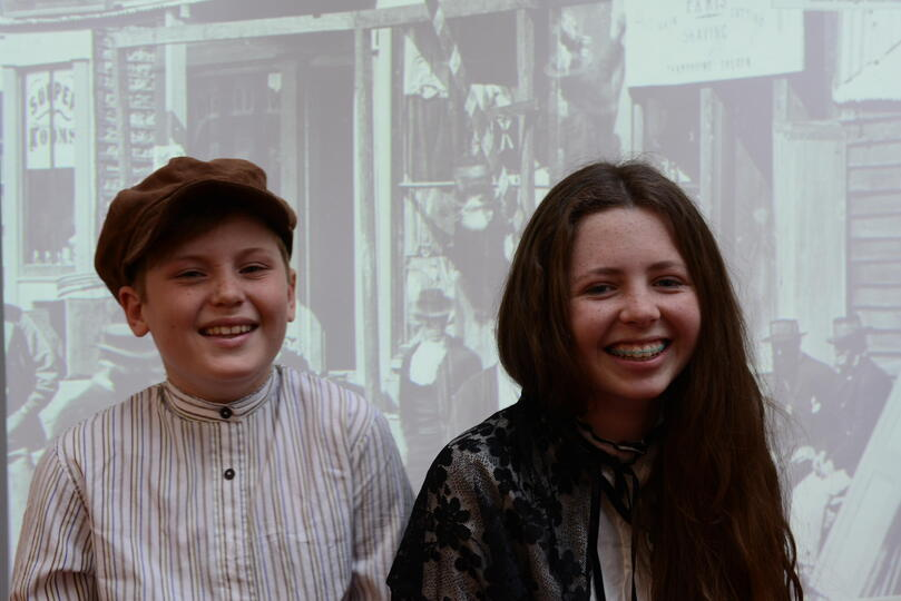 Two students dressed in mining costumes